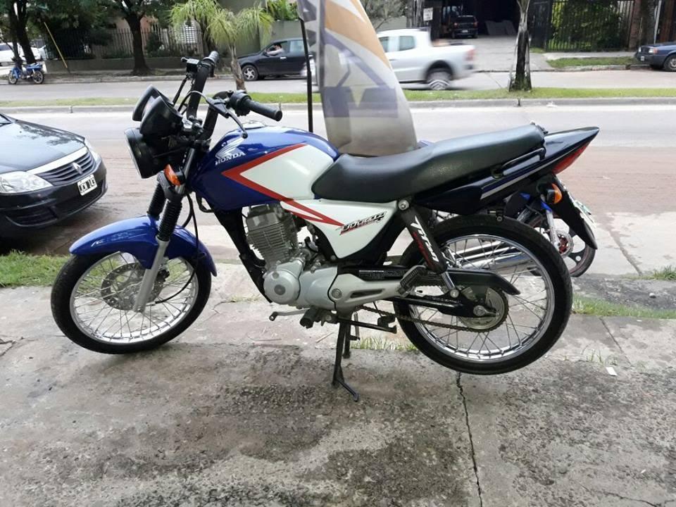 vendo titan 2014..recibo motos..financio algo
